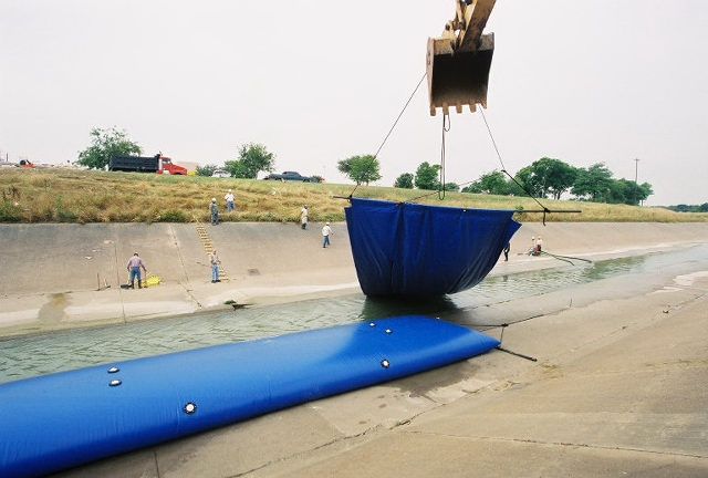 Installing an Inflatable Bladder Dam in Water